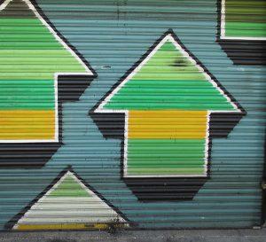 Graffiti showing upward pointing arrows