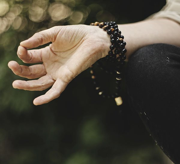 Hand in meditation pose
