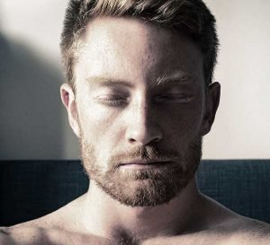 Depressed man with eyes closed