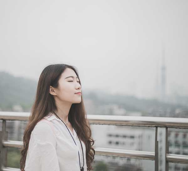 Woman with eyes closed looking calm