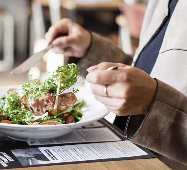 Close up of businessman eating a dish in a restaurant